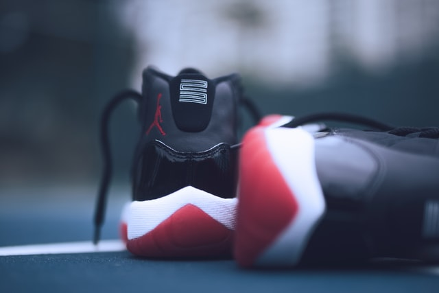 shallow focus photo of pair of bred Air Jordan 11's