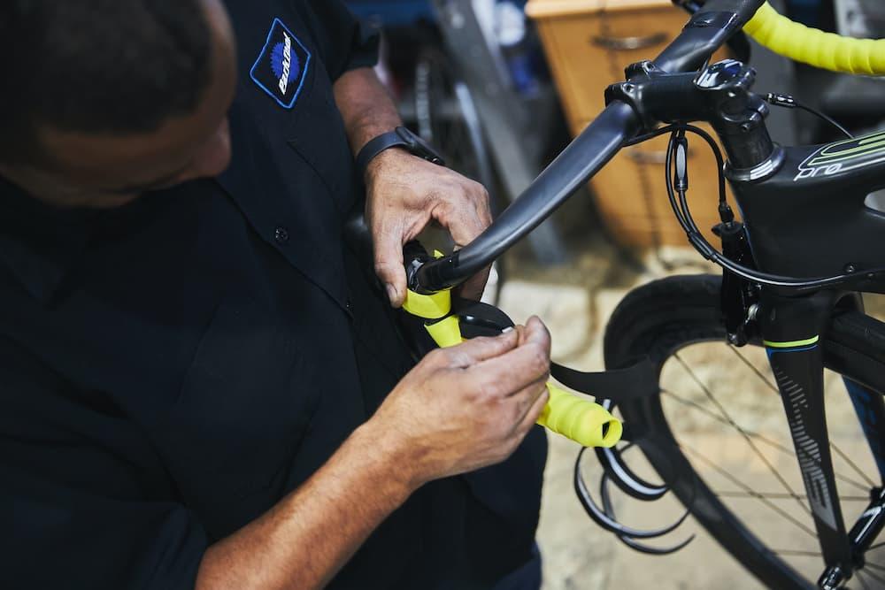 bike mechanic working on bicycle