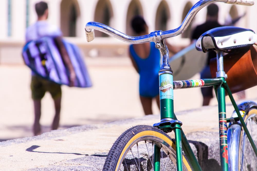 Read more about the article How To Carry A Surfboard On A Bike?